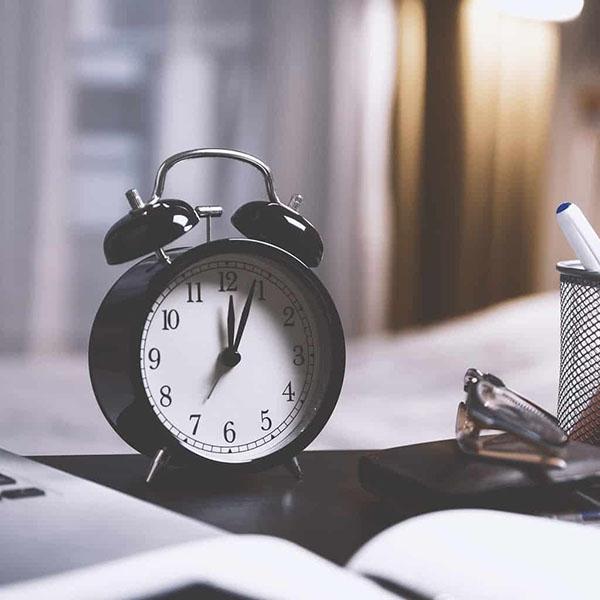 Black clock on desk