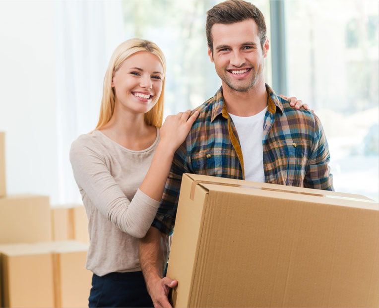 Couple holding a recently delivered package